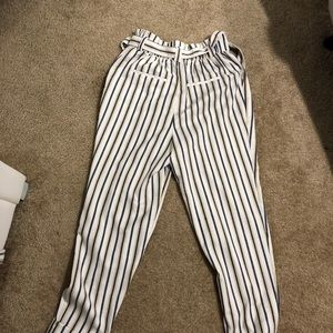 White blue and yellow striped trousers